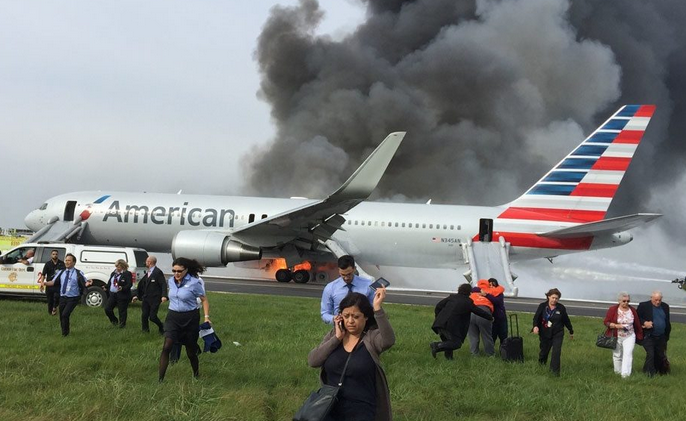 Airline passengers evacuating in a fire emergency