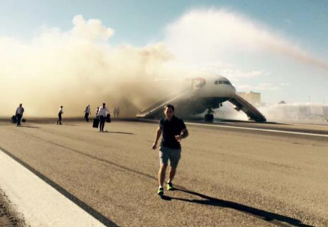 Passengers flee a burning 777 in Las Vegas. Photo by Jacob Steinberg